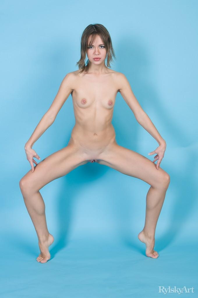 Naked Kalla is posing at a blue studio - 2