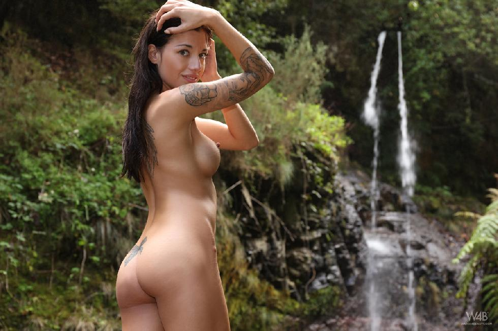 Girl with tattoo is posing in nature - Dellai - 1