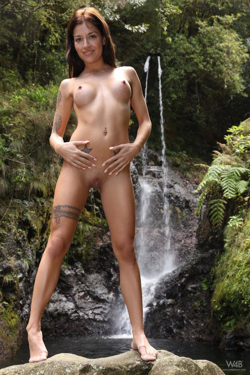 Girl with tattoo is posing in nature - Dellai - 3