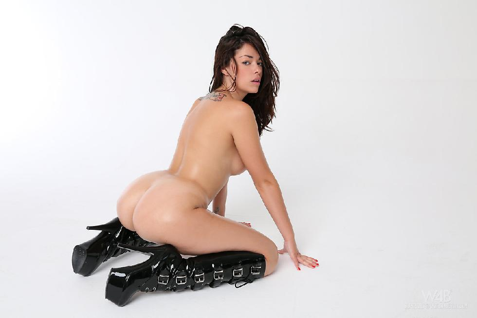 Ava is posing in sexy black high boots - 12