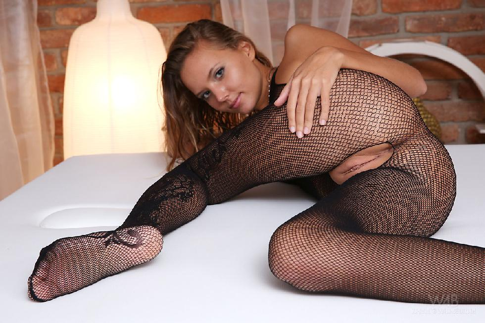 Young girl in sexy black bodystocking - Clover - 2