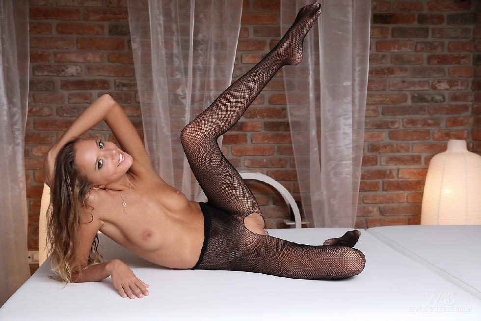 Young girl in sexy black bodystocking - Clover - 9