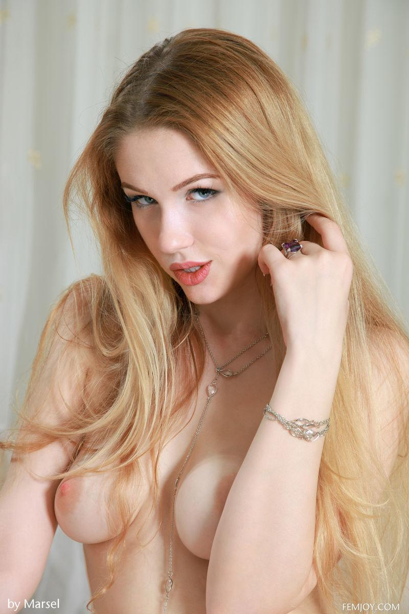 Long-haired beauty is posing on the table - Xana - 2