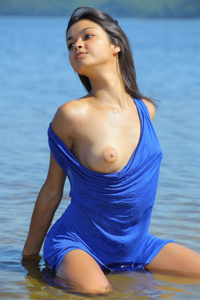Halina is showing her young tanned body