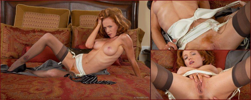 Red-haired temptress is posing on the bed - Heather Carolin - 15
