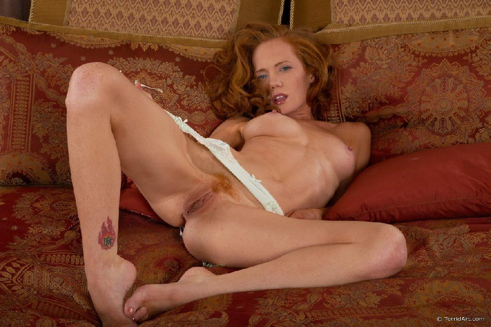 Red-haired temptress is posing on the bed - Heather Carolin - 11