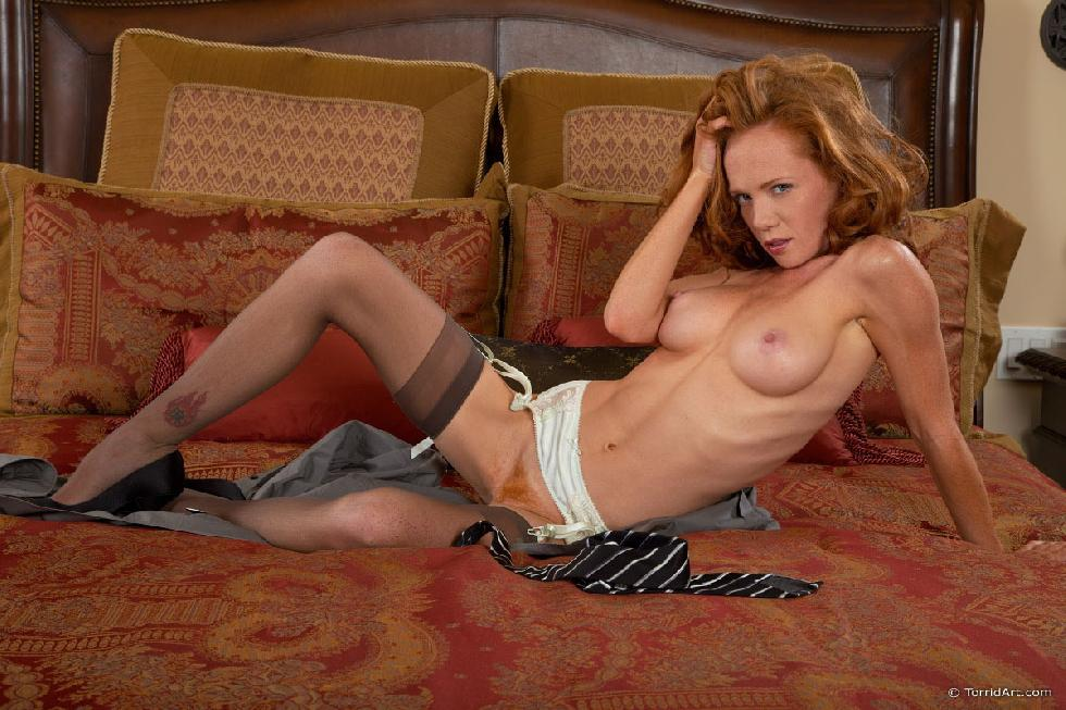 Red-haired temptress is posing on the bed - Heather Carolin