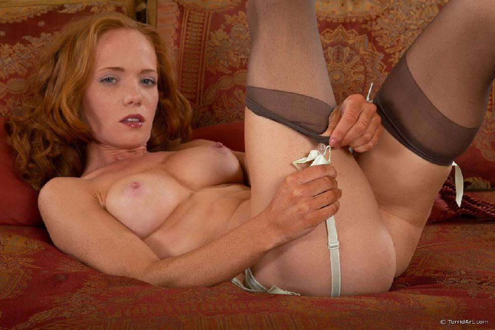 Red-haired temptress is posing on the bed - Heather Carolin - 7