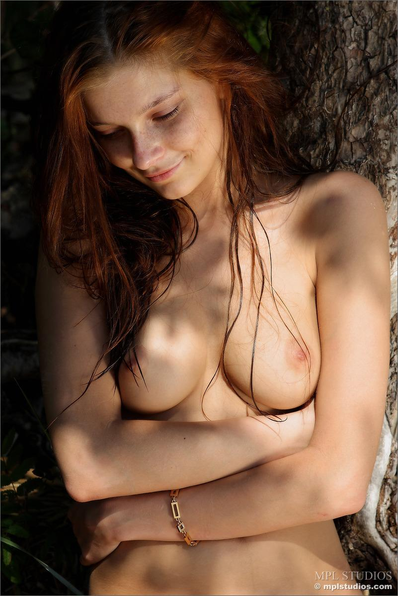 Naked redhead is posing on the beach - Ava - 11