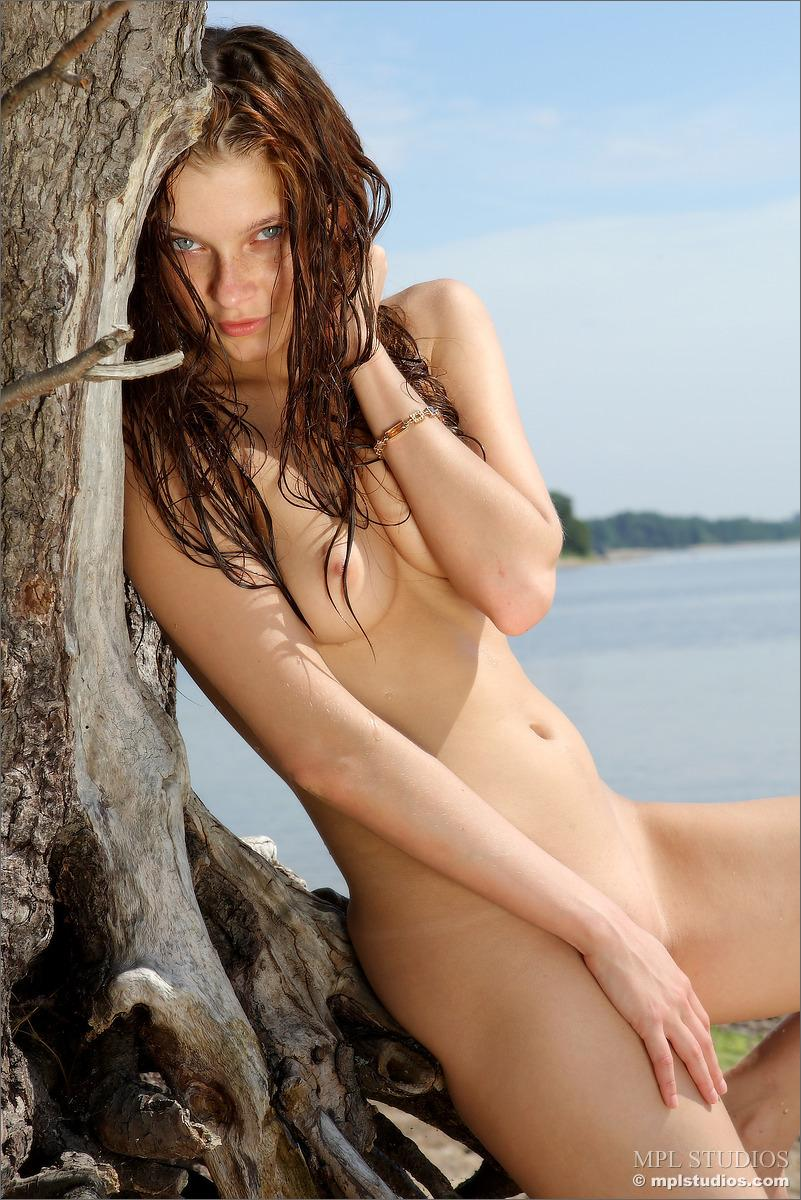 Naked redhead is posing on the beach - Ava - 4