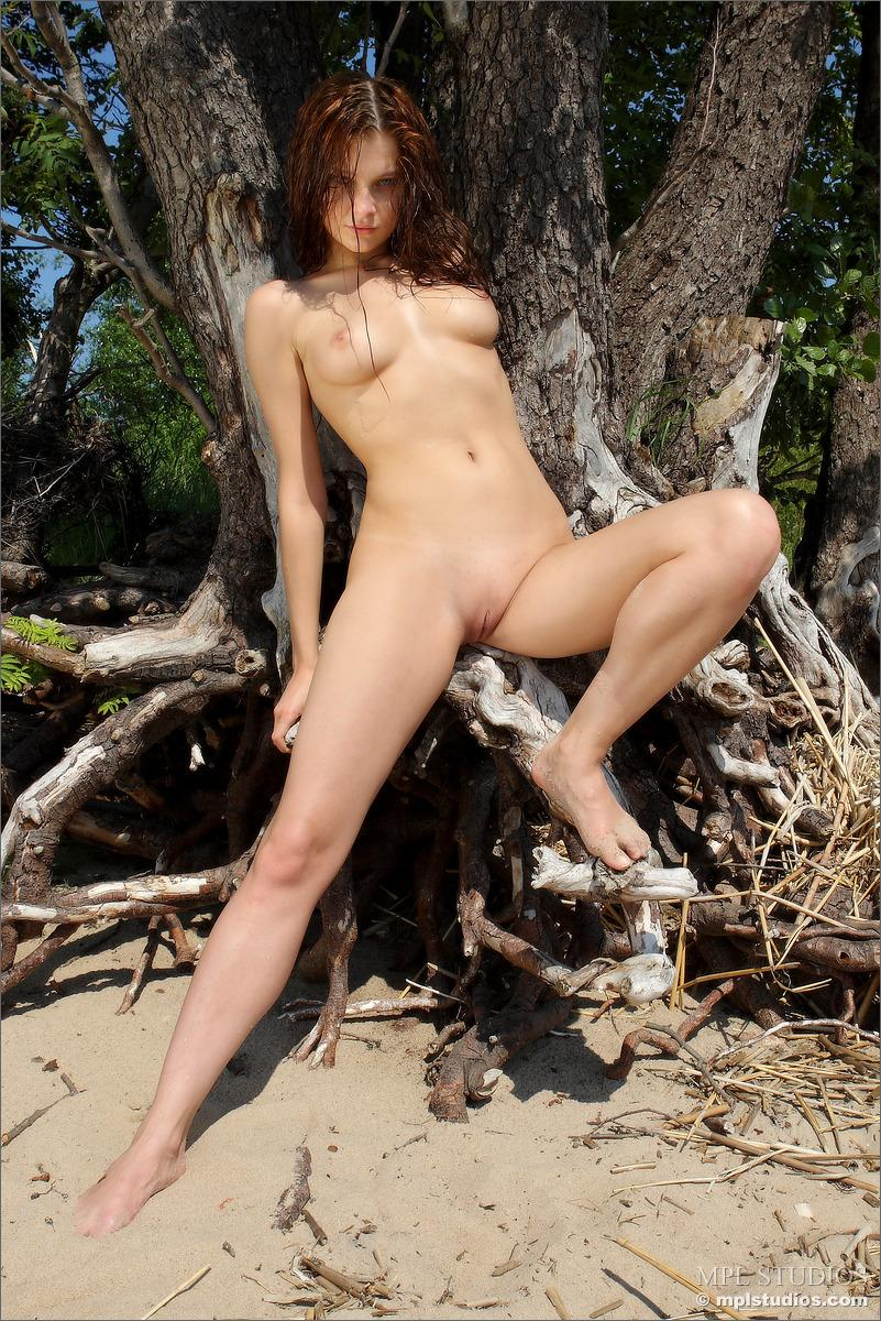 Naked redhead is posing on the beach - Ava - 5