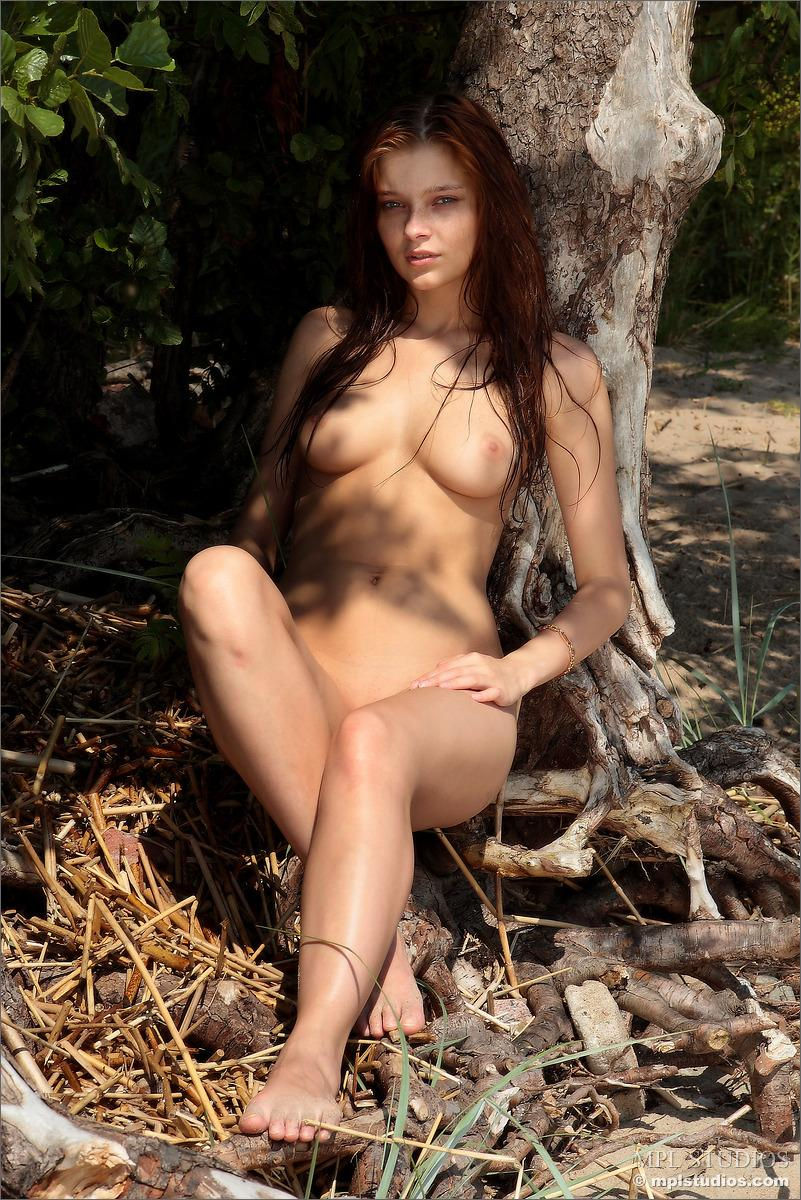 Naked redhead is posing on the beach - Ava - 9