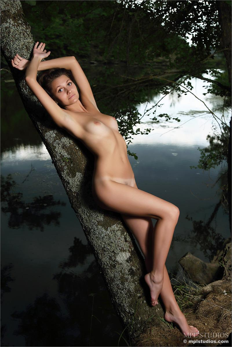 Young Carmela is posing in nature - 4