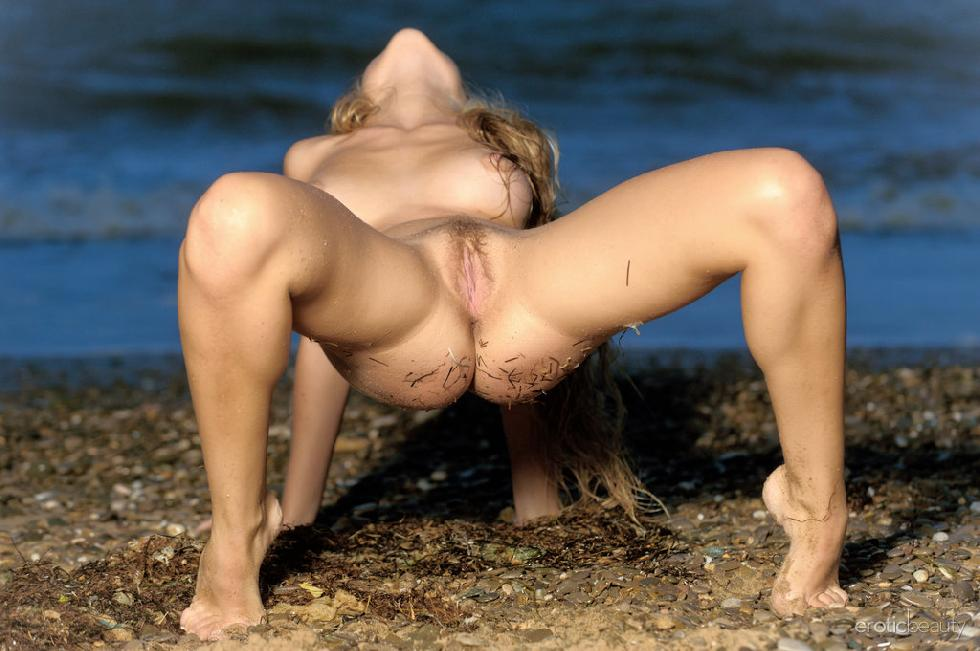 Chloe is posing naked on the beach - 14