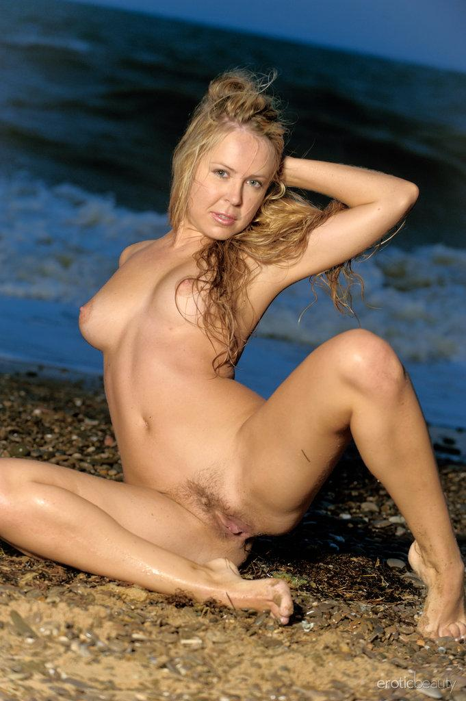 Chloe is posing naked on the beach - 15