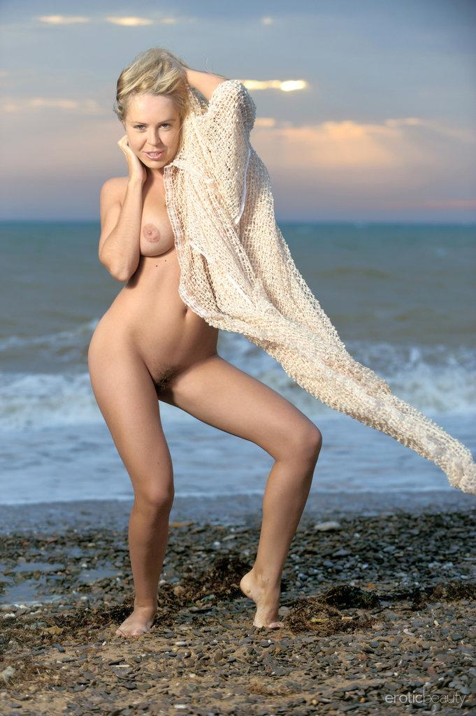 Chloe is posing naked on the beach - 2