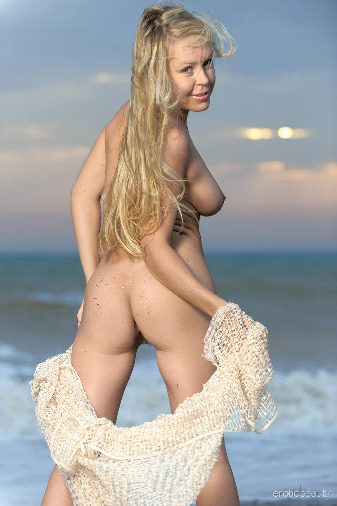 Chloe is posing naked on the beach - 3