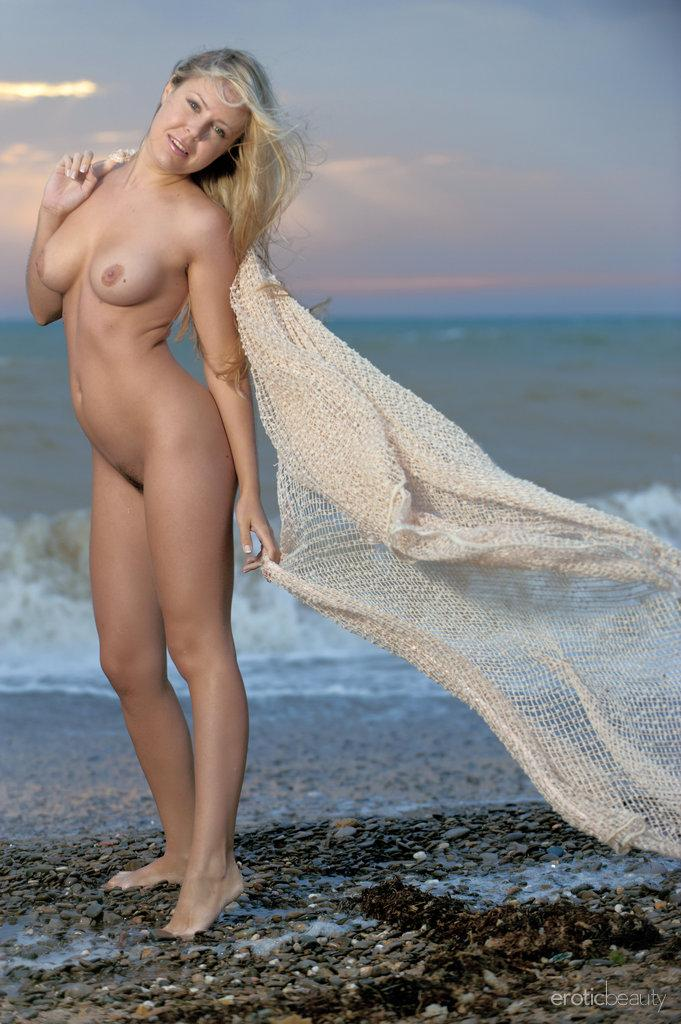 Chloe is posing naked on the beach - 5