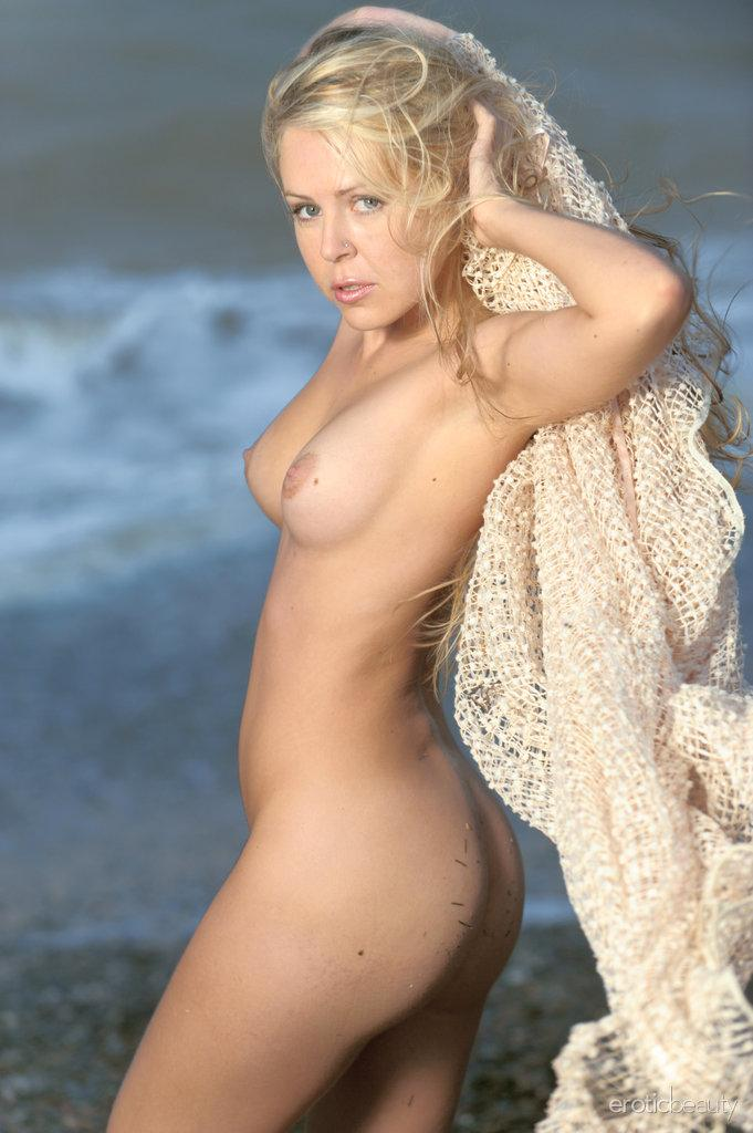 Chloe is posing naked on the beach - 6