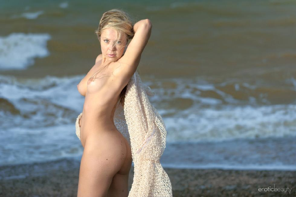 Chloe is posing naked on the beach - 7