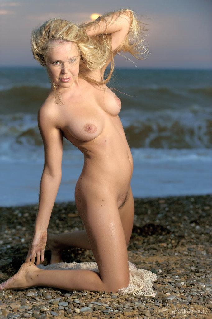 Chloe is posing naked on the beach - 9
