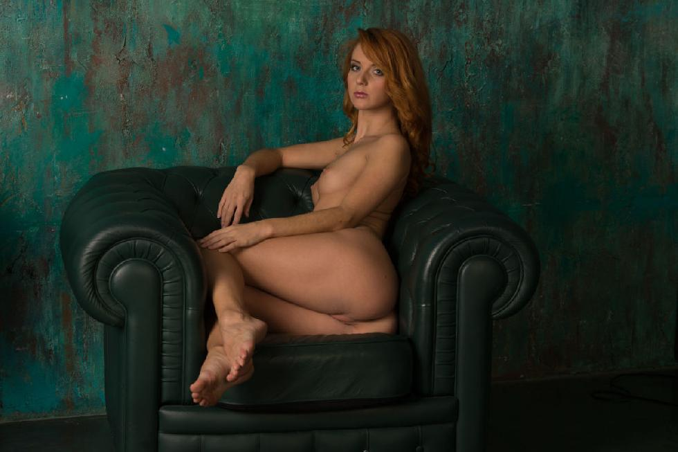 Beautiful redhead is posing on the armchair - Roberta Berti - 5
