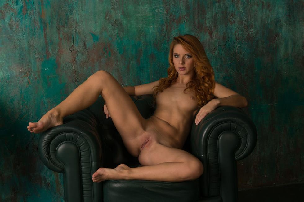 Beautiful redhead is posing on the armchair - Roberta Berti - 6