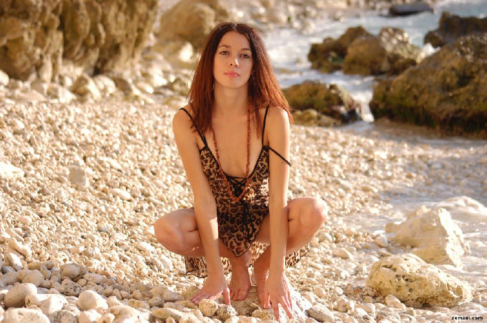 Young redhead on the rocky beach - Dillia - 1