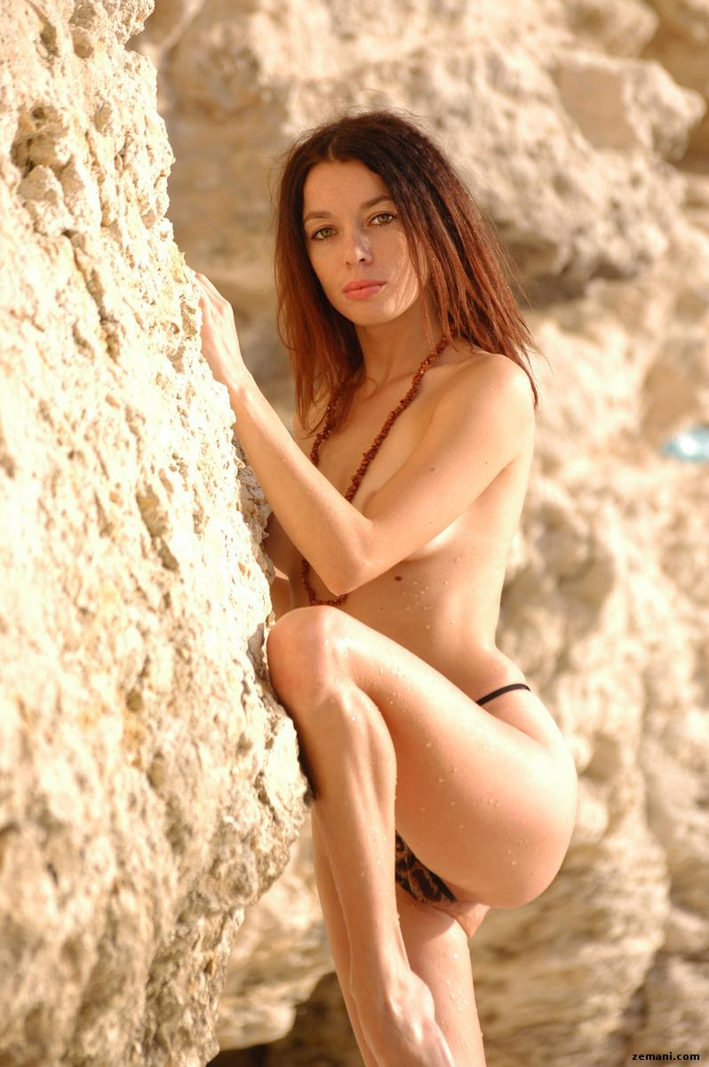 Young redhead on the rocky beach - Dillia - 3