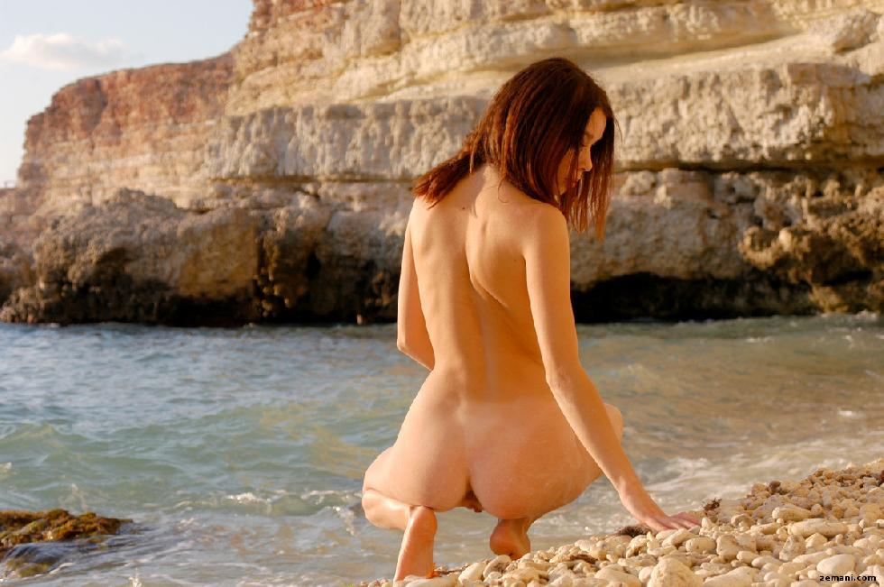 Young redhead on the rocky beach - Dillia - 9