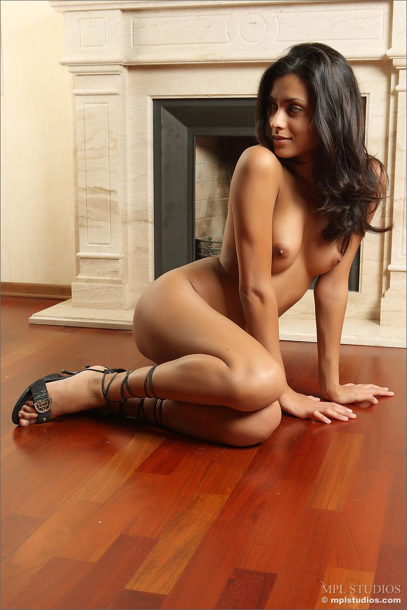 Young Latina is posing by a fireplace - Bianca - 12