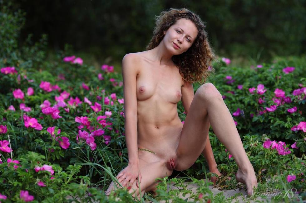 Young Kailin is posing between flowers - 10