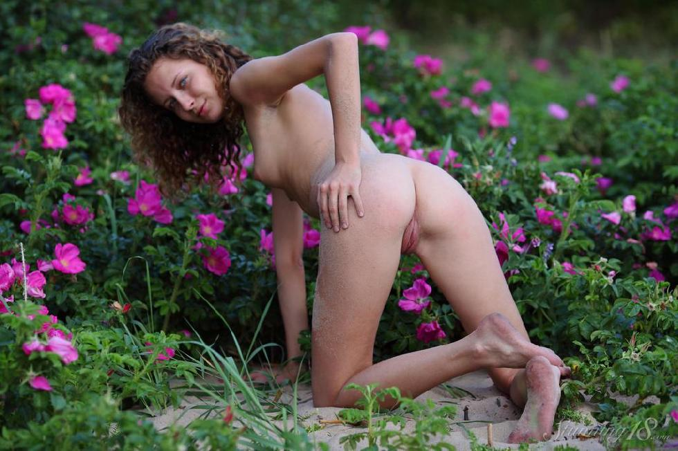 Young Kailin is posing between flowers - 12
