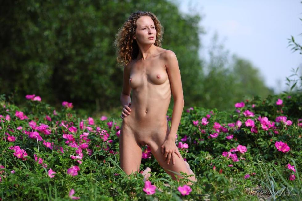 Young Kailin is posing between flowers - 8