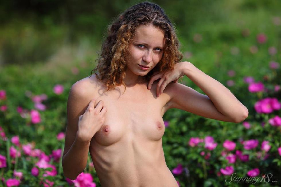Young Kailin is posing between flowers - 9