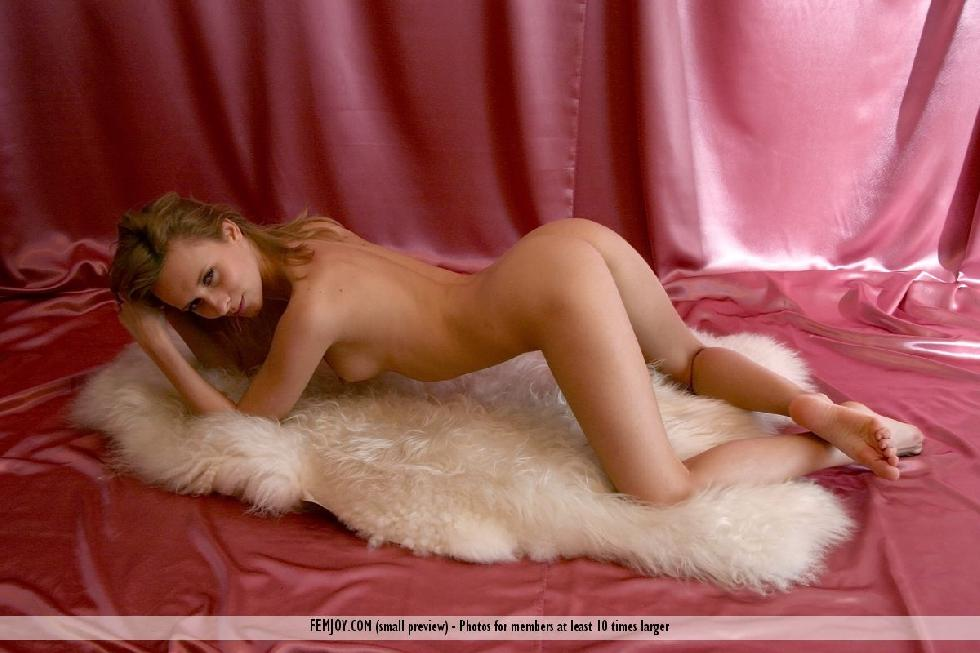 Naked girl is posing on the fur - Odele