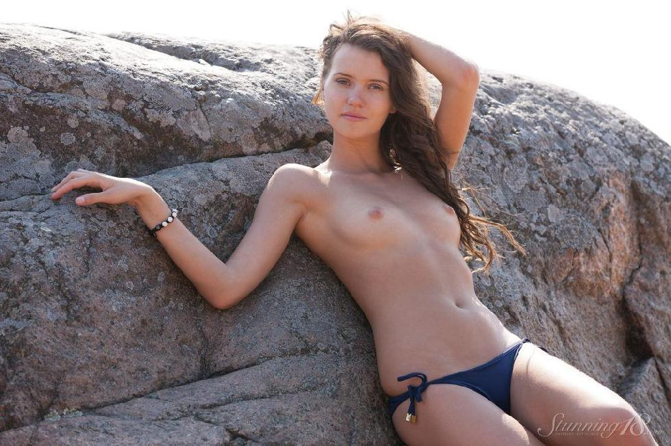 Stunning Lucy has a photoshoot on the beach