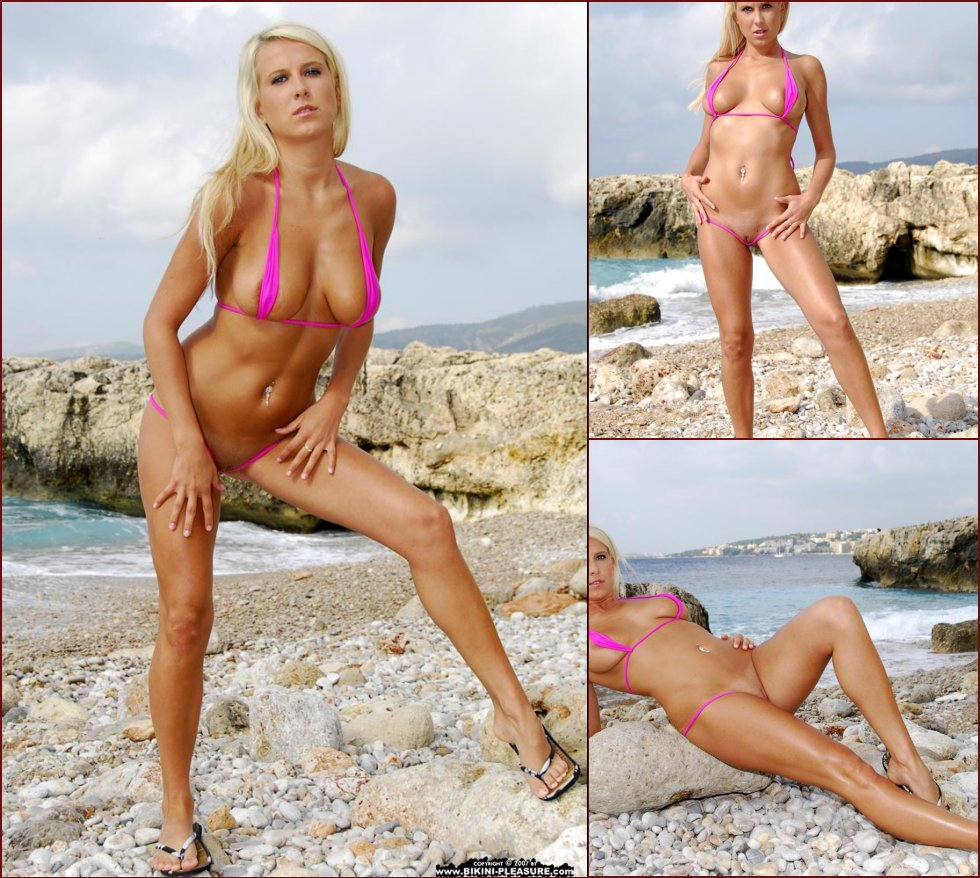 Busty Samantha is posing on the rocky beach - 1