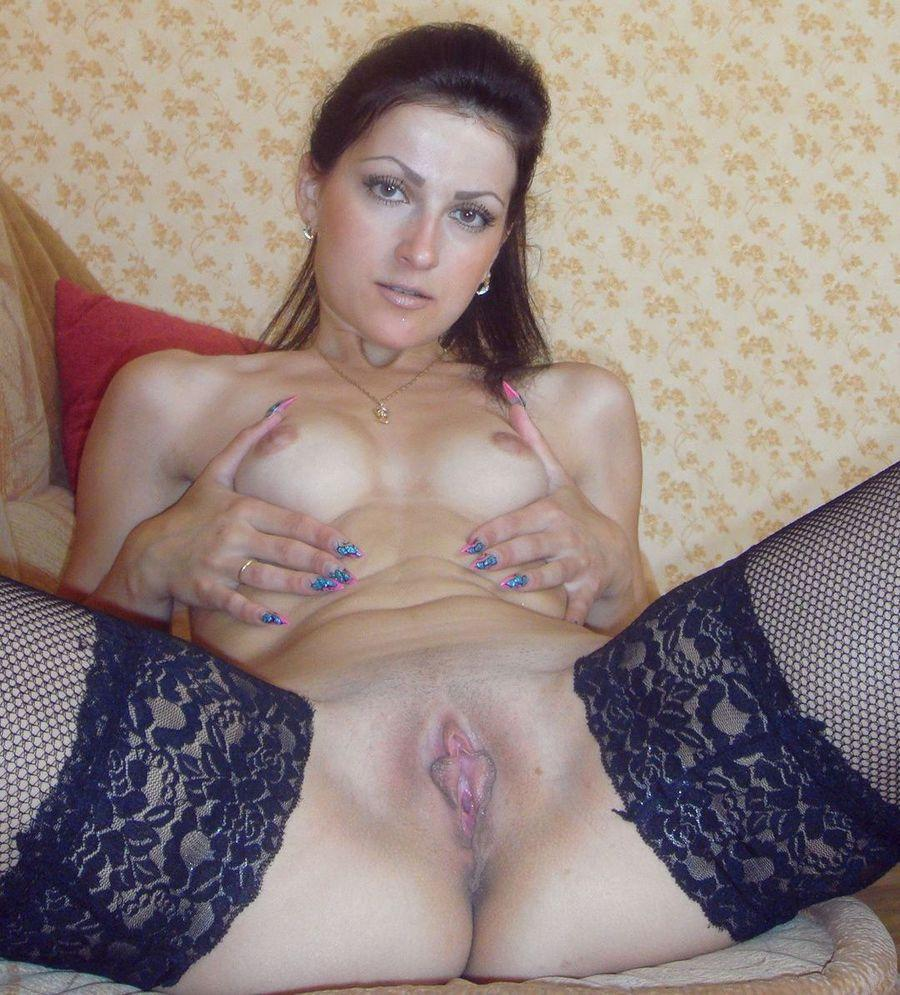 Sexy brunette shows pink meaty pussy - 4