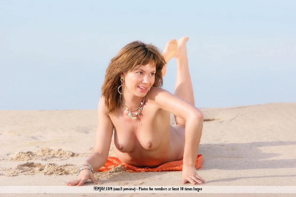 Ayla is posing naked on the beach - 14
