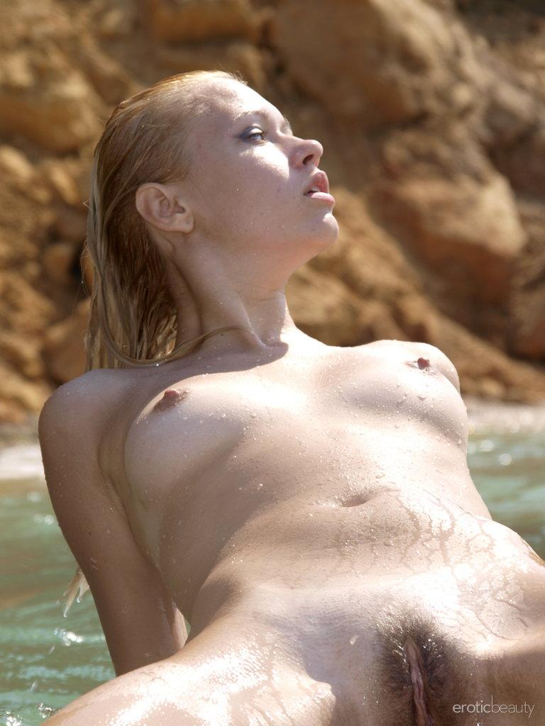 Young Angie is showing her wet body - 16