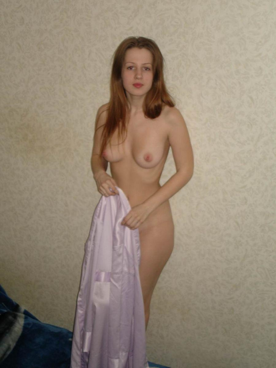 Young redhead is showing her sweet boobies - 8