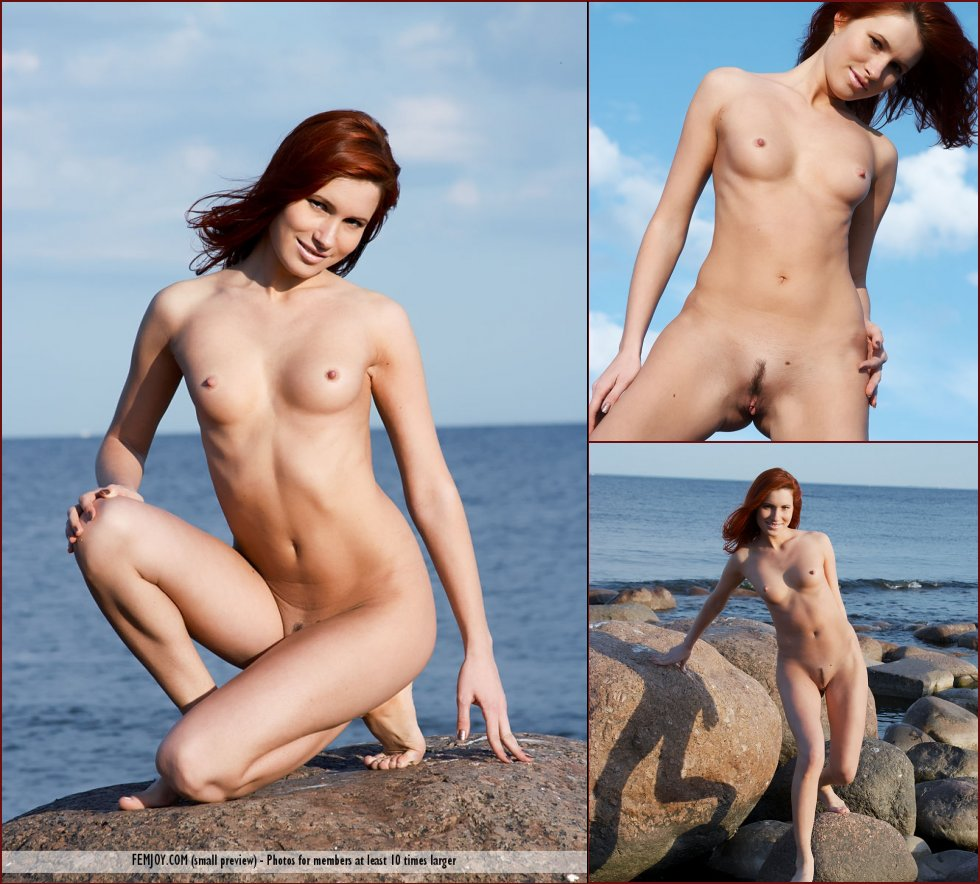 Naked redhead is posing on the rocks - Leila - 3