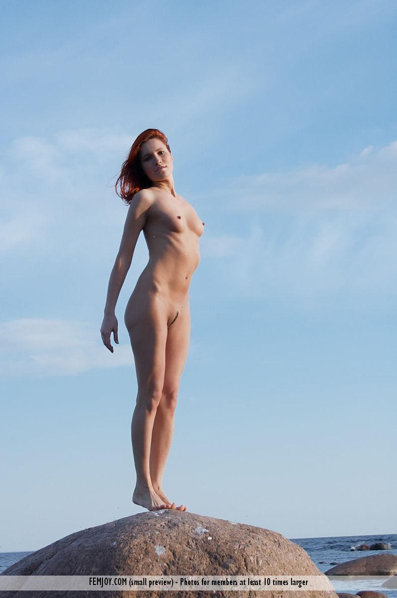 Naked redhead is posing on the rocks - Leila - 10