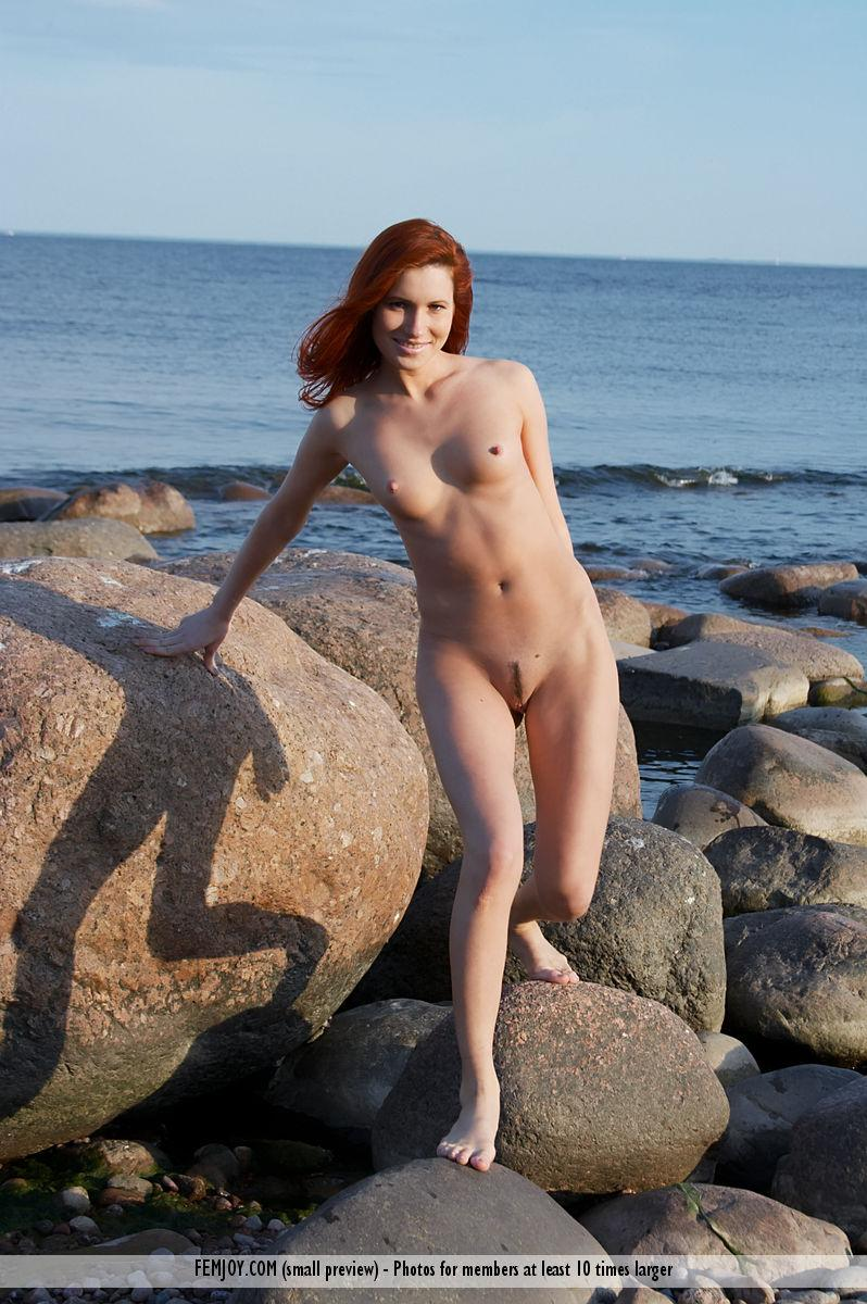 Naked redhead is posing on the rocks - Leila - 11