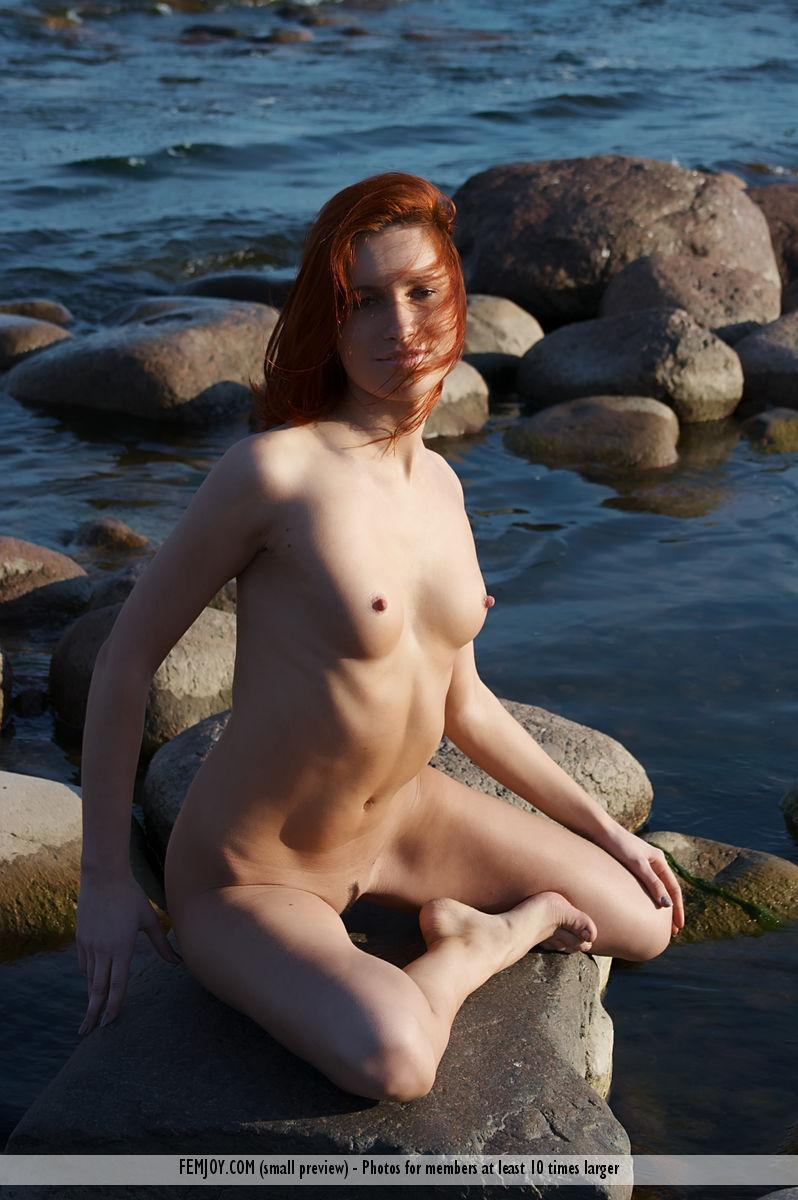 Naked redhead is posing on the rocks - Leila - 15