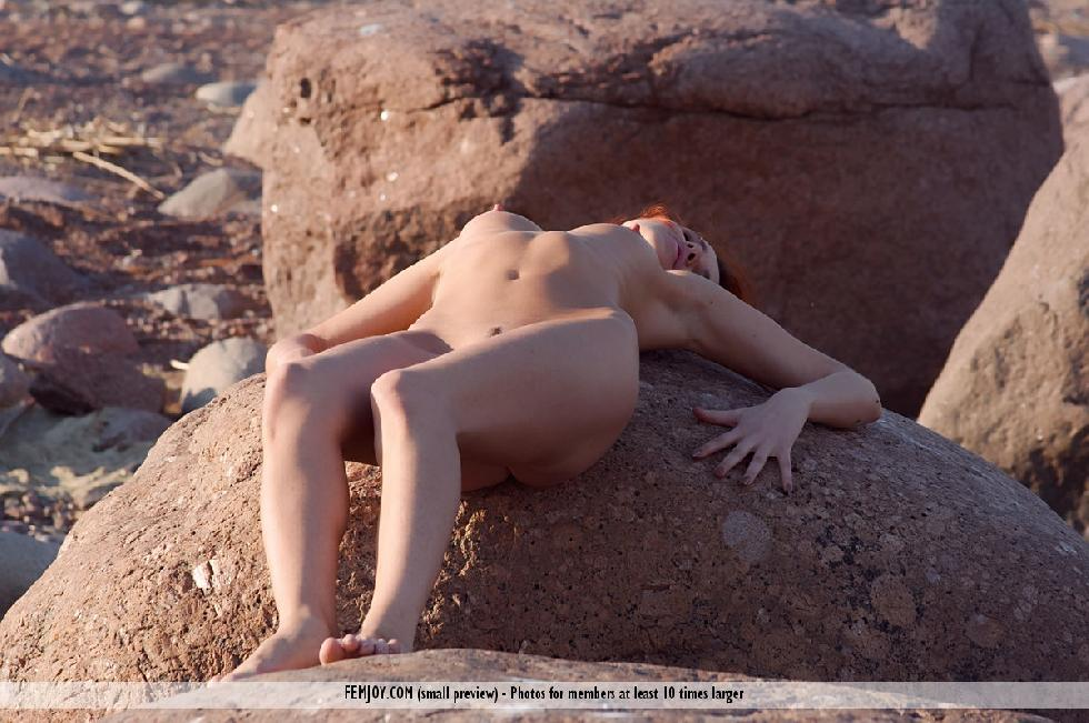 Naked redhead is posing on the rocks - Leila - 4