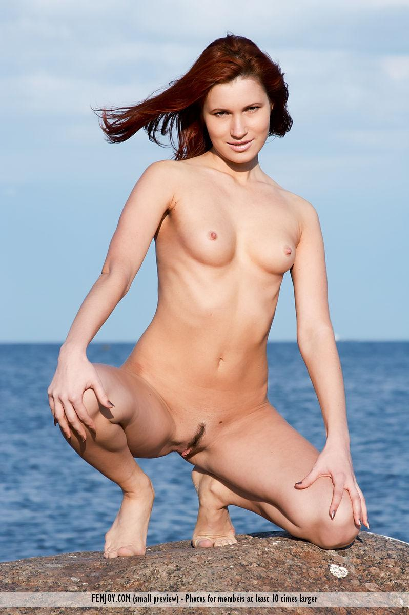 Naked redhead is posing on the rocks - Leila - 6