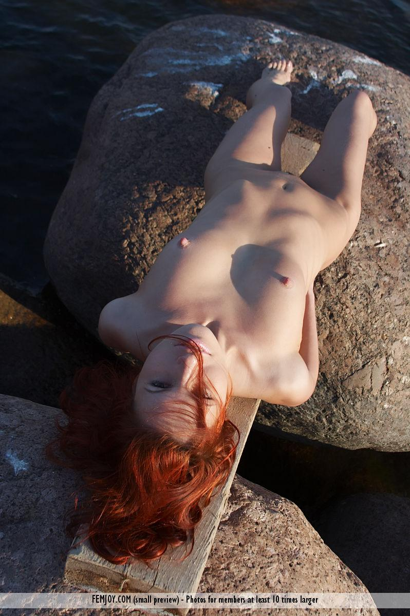 Naked redhead is posing on the rocks - Leila - 8