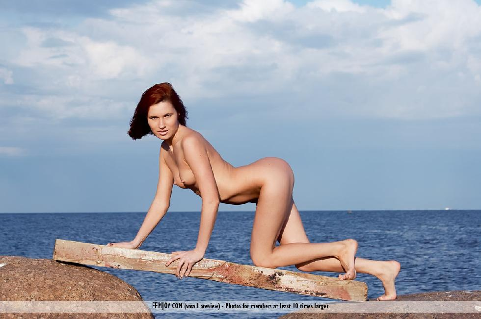 Naked redhead is posing on the rocks - Leila - 9